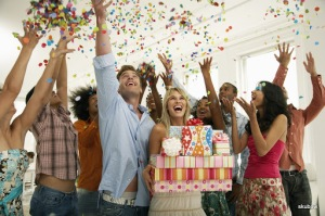 Happy People at a Birthday Party --- Image by © Royalty-Free/Corbis